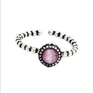 Purple opened opal ring